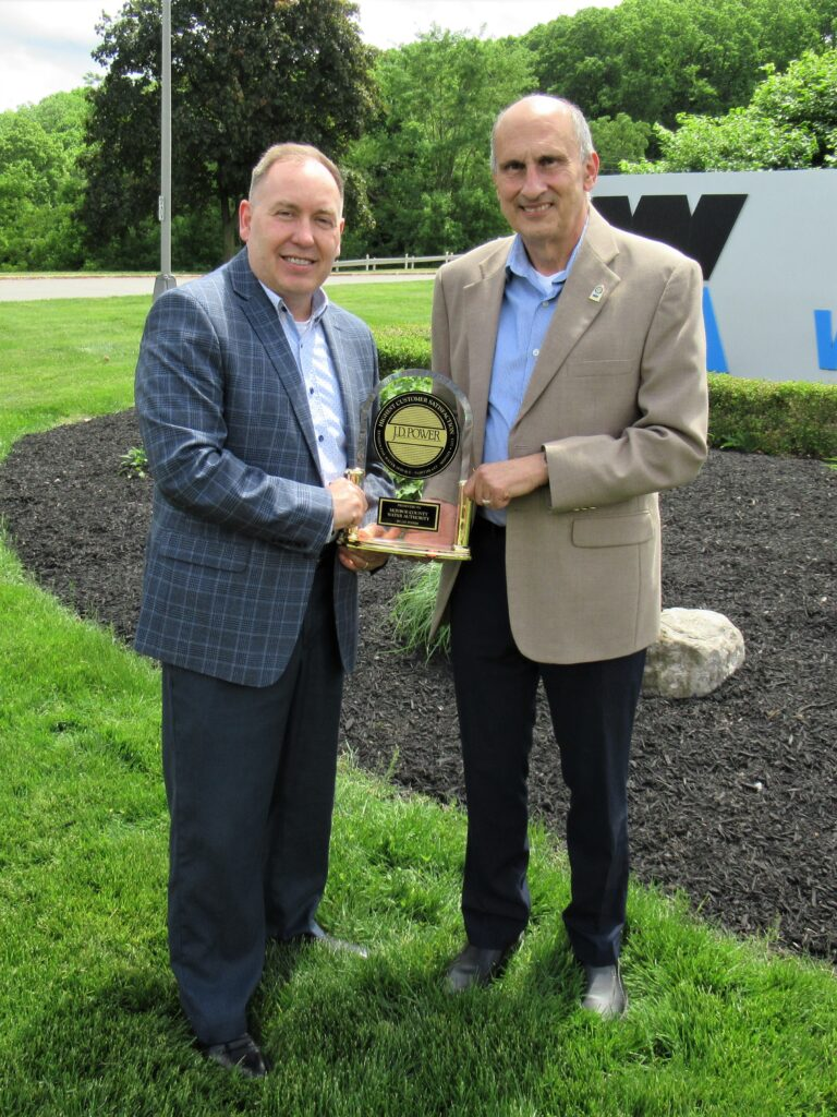 Board Chair Scott Nasca and Executive Director Nick Noce with JD Power Award trophy