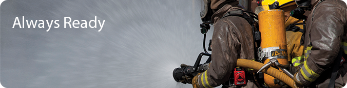 Always Ready Banner with picture of firemen holding hose with water coming out.