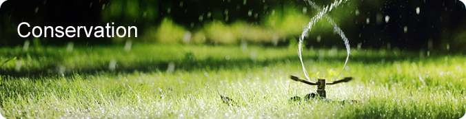 Conservation Banner displaying a water sprinkler on top of grass.